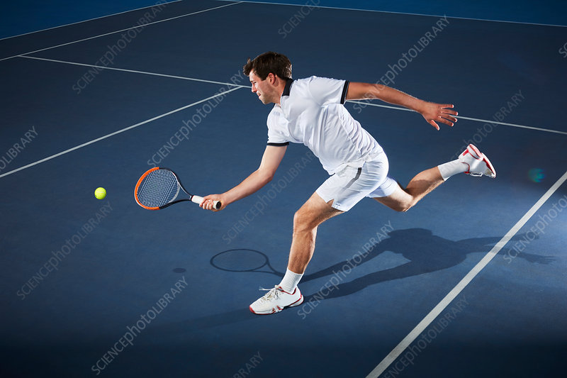 Male tennis player playing tennis