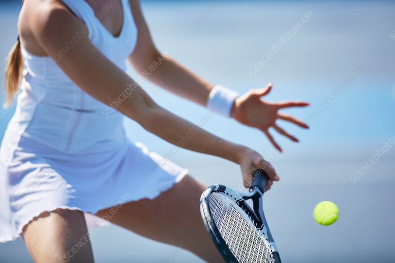 Female tennis player playing tennis
