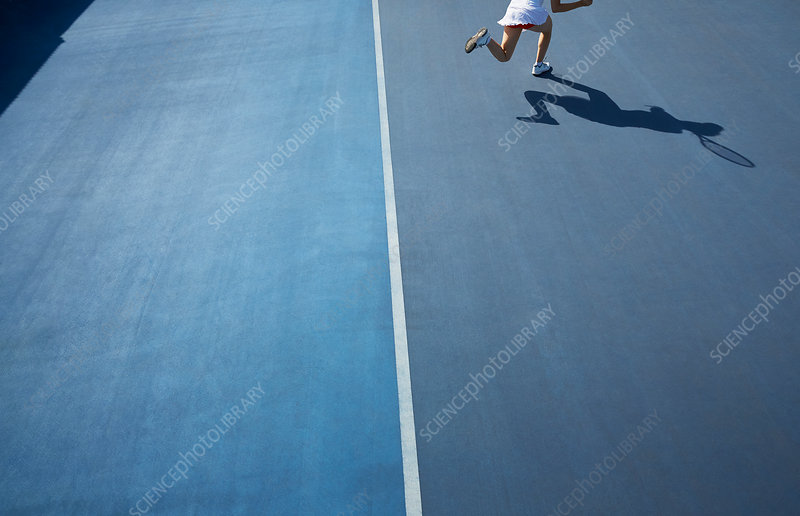 Shadow of tennis player running