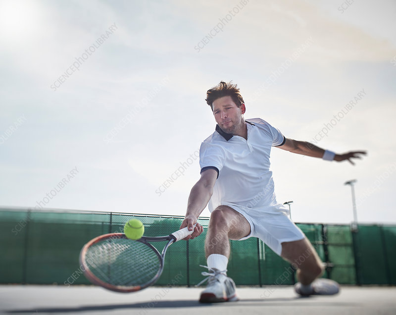 Determined tennis player playing tennis