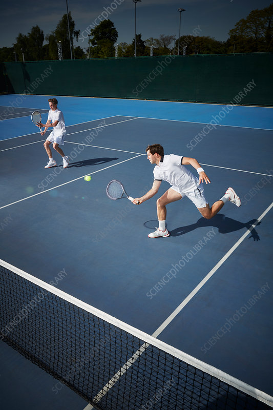 Young tennis doubles players playing tennis