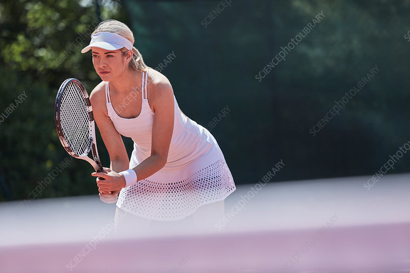 Focused tennis player ready, holding tennis racket