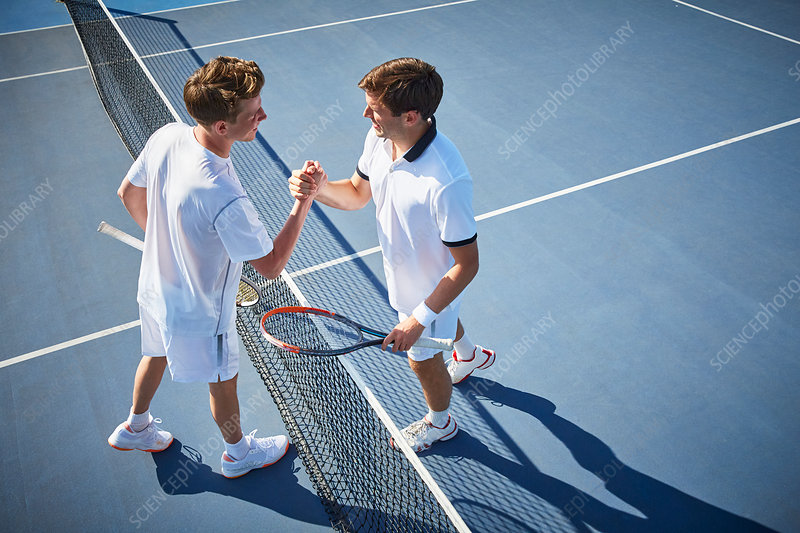 Young tennis players handshaking