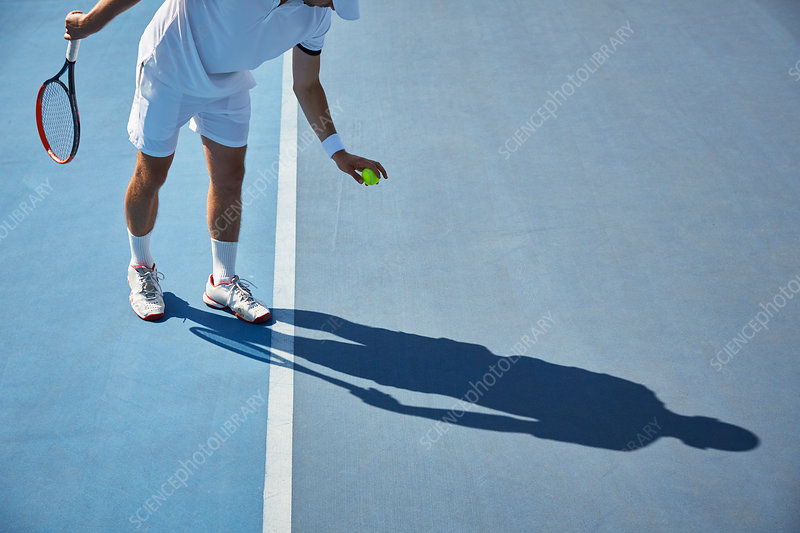 Young tennis player playing tennis