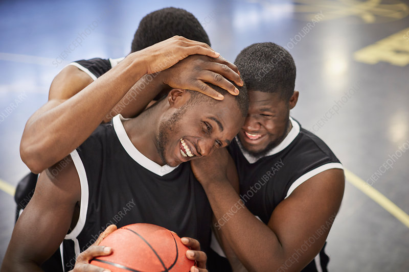 Happy basketball players hugging