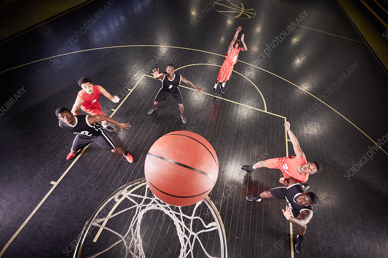 Overhead view basketball player shooting free