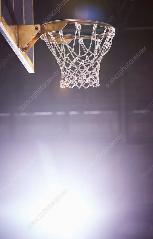 Lens flare around brightly lit basketball hoop