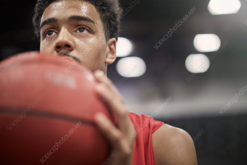 Close up basketball player holding basketball