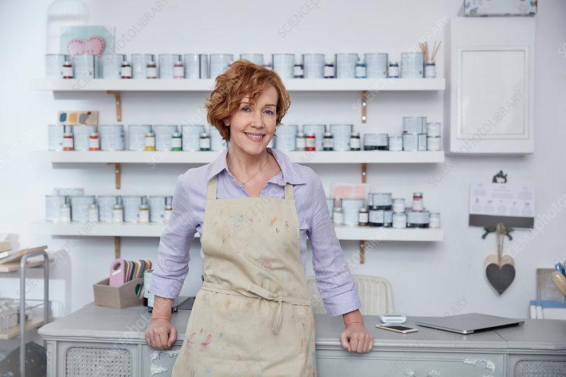 Portrait female business owner in art paint shop