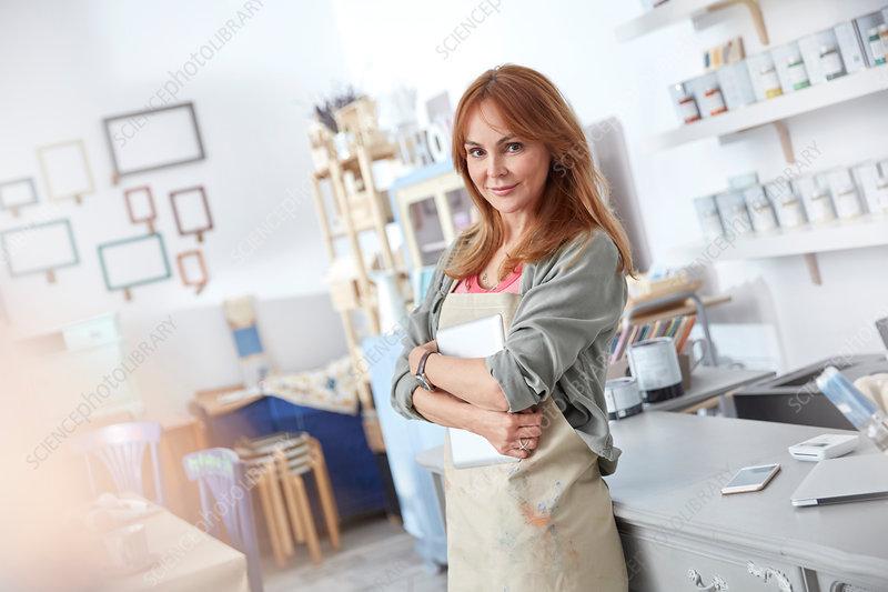 Portrait business owner working in art shop