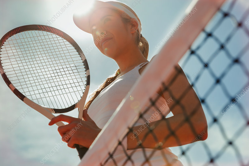 Confident tennis player holding tennis racket