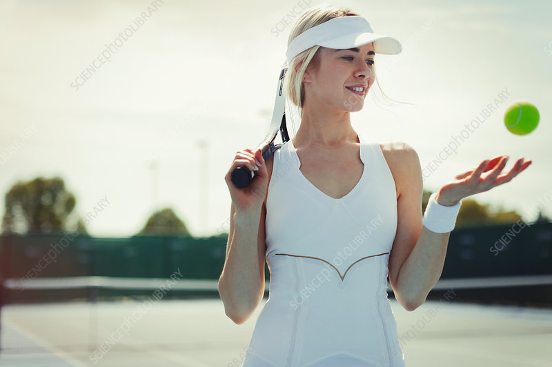 Smiling tennis player holding tennis racket