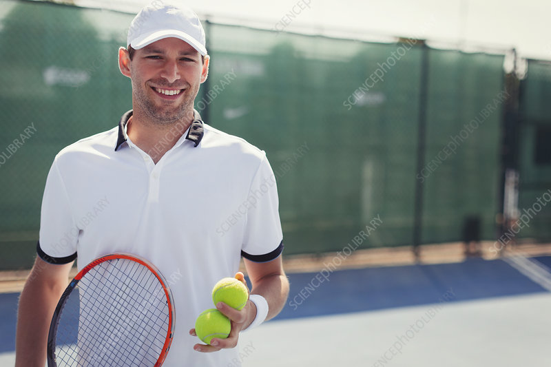 Portrait tennis player holding tennis racket