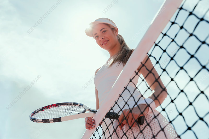 Portrait tennis player holding tennis racket