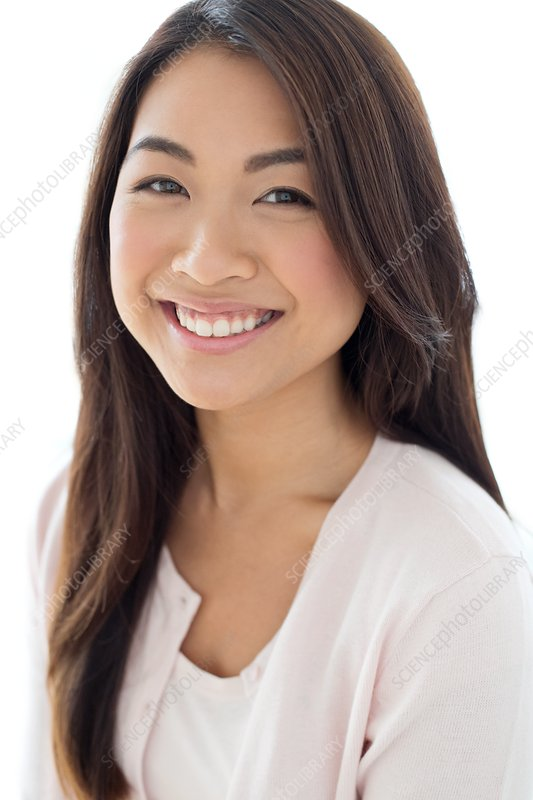 Woman with long brown hair smiling towards camera