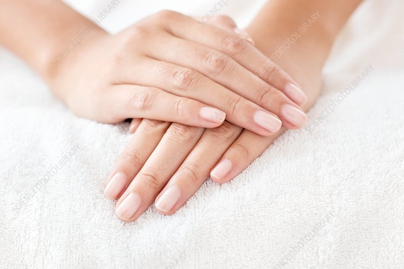 Woman with hands resting on white towel