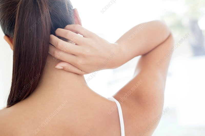 Woman scratching neck