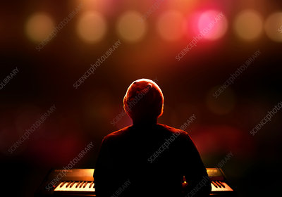 Person playing piano on stage