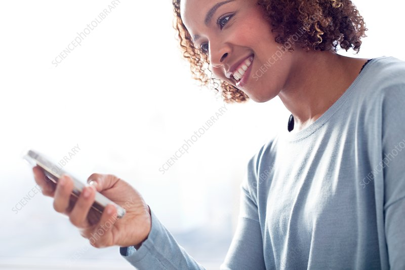 Mid adult woman using phone