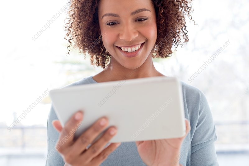 Mid adult woman using tablet