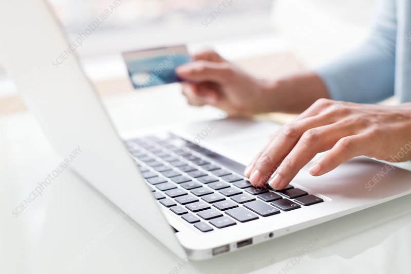 Woman using credit card and laptop