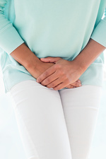 Woman clutching stomach in pain