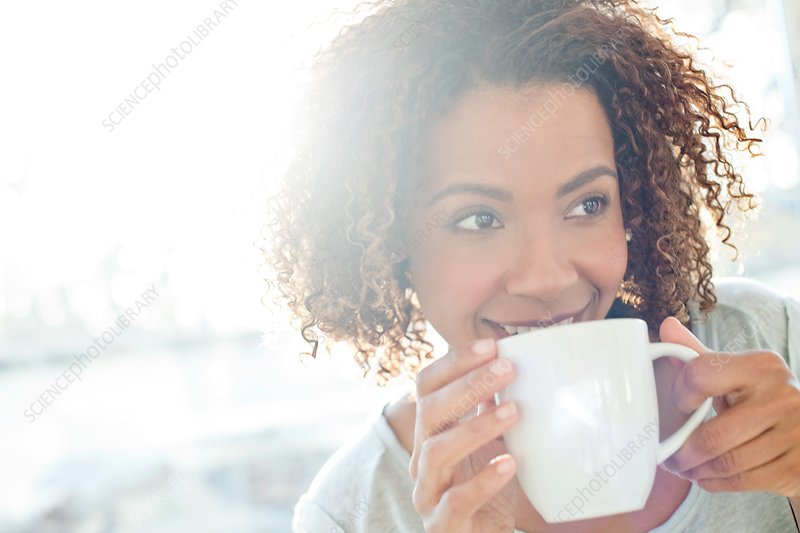 Mid adult woman drinking coffee