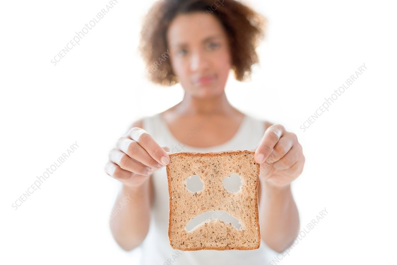 Woman holding bread with sad face