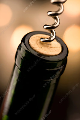 Wine bottle with corkscrew removing cork