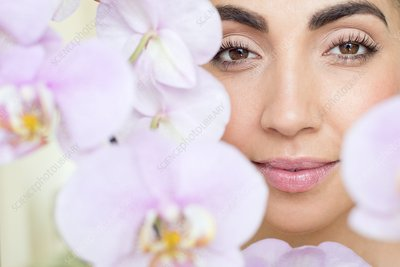 Woman and pink orchids