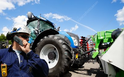 Mechanic with farming machines