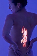 Woman with back pain, conceptual image