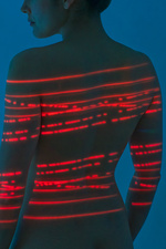 Woman with red lights on back