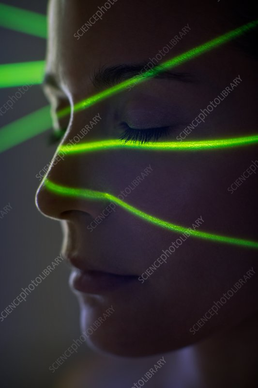 Woman with green lights on face