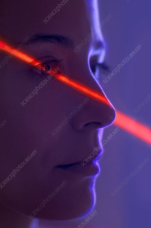 Woman with red light on face
