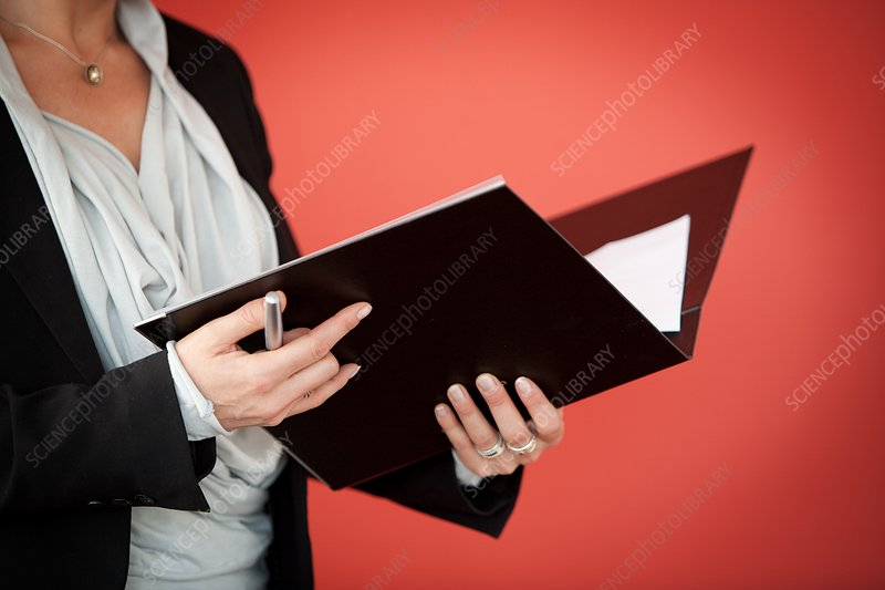 Businesswoman holding black folder