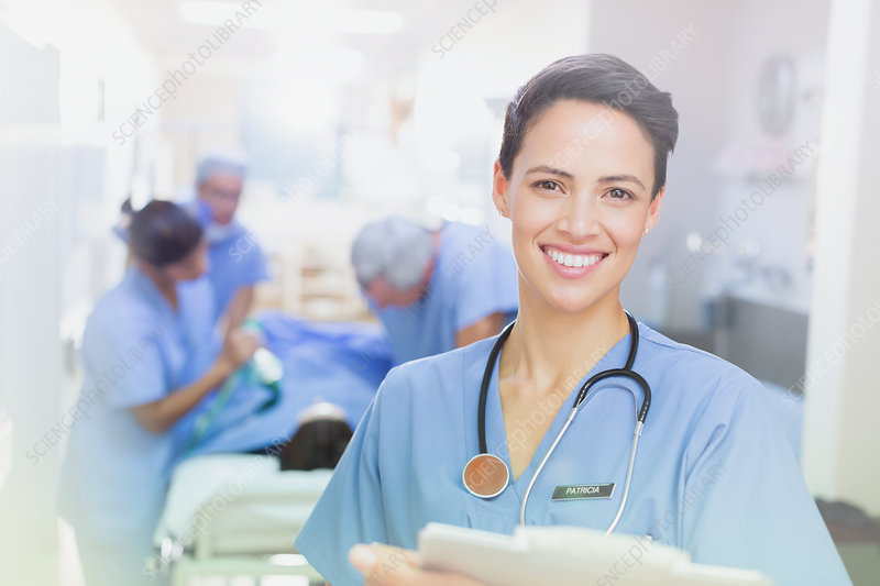 Portrait smiling female surgeon with clipboard