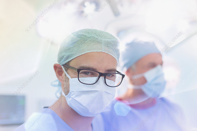 Surgeon wearing eyeglasses and surgical mask