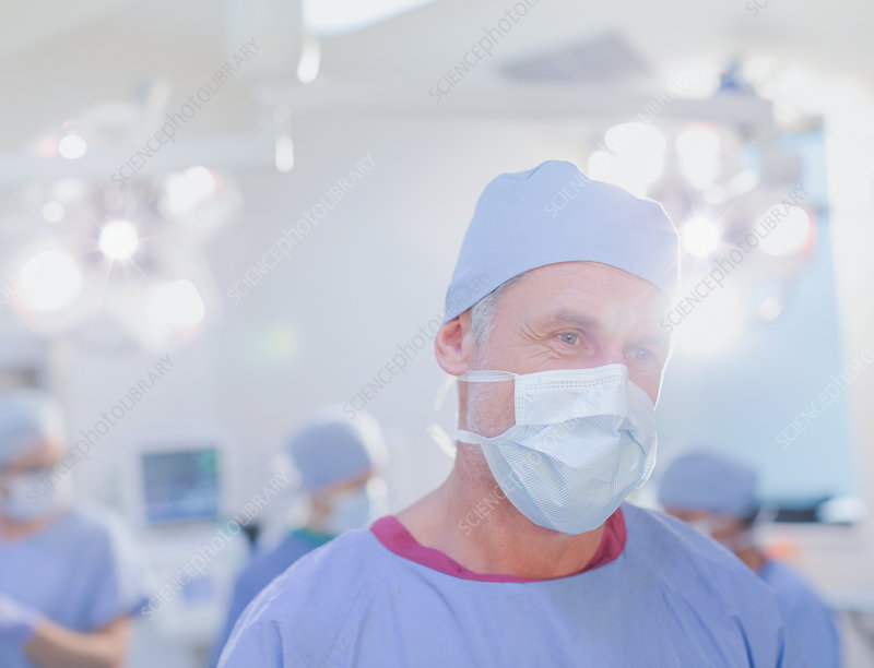 Mature male surgeon in surgical mask