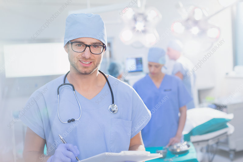 Surgeon in eyeglasses with clipboard