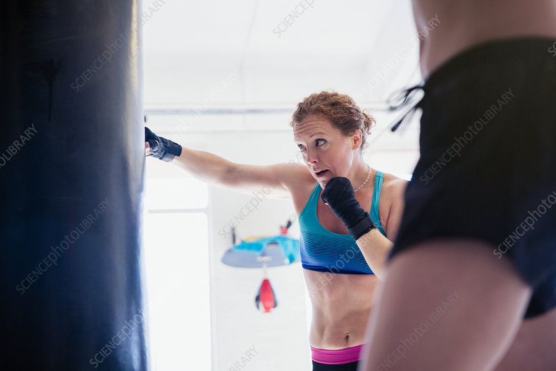 Determined, boxer boxing at punching bag