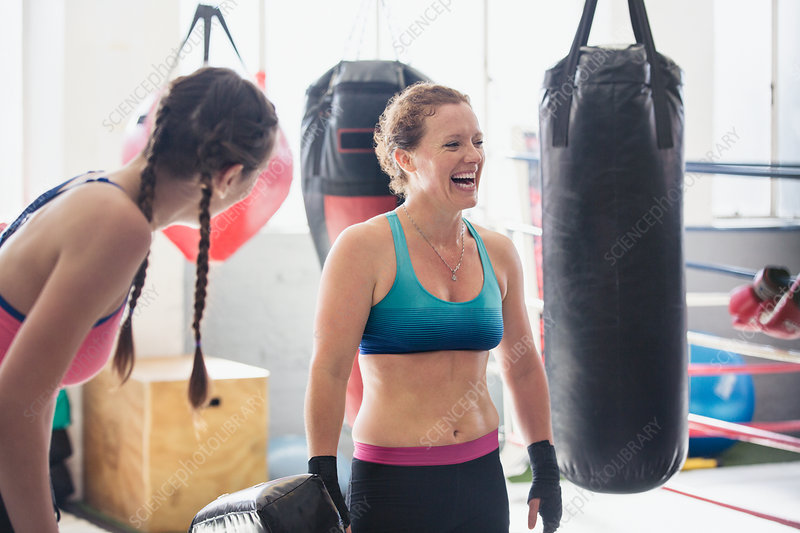 Laughing boxers next to punching bags