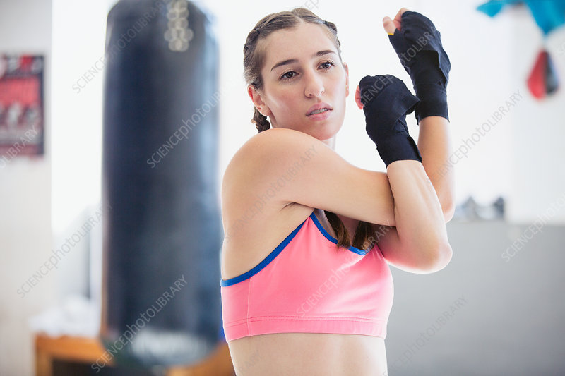 Young boxer stretching shoulder and arms