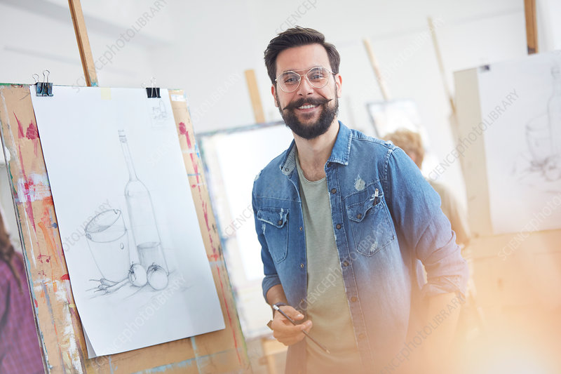 Portrait male artist with beard sketching