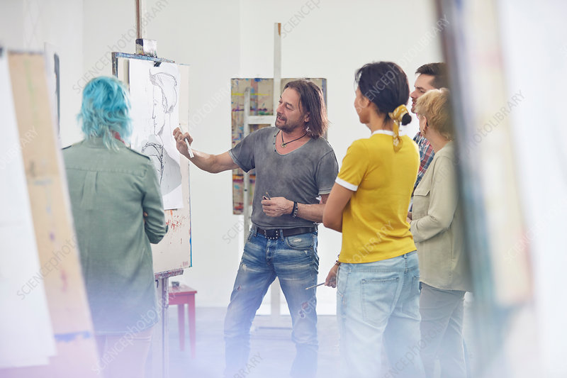 Students listening to instructor sketching