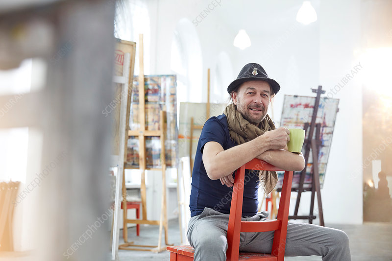 Artists drinking coffee painting at easel