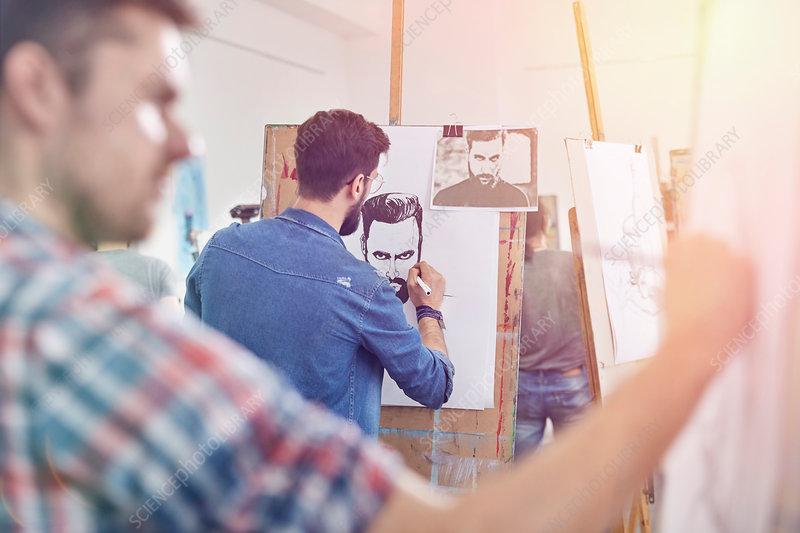 Male artists sketching in art class studio