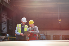 Male foreman and worker talking