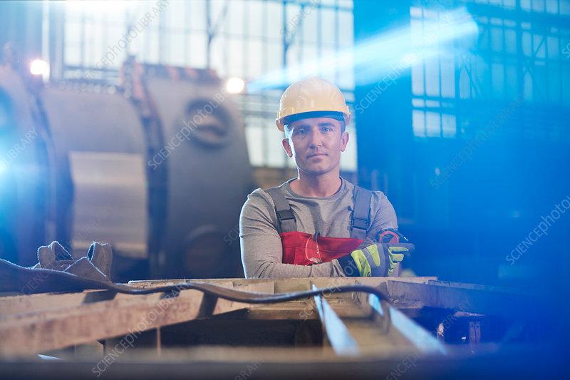 Portrait tough male worker working in factory