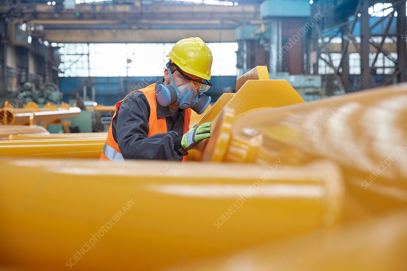 Steel worker wearing protective face mask